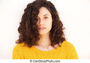 Close up attractive young woman against white background staring