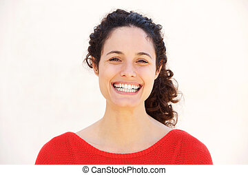 Close up attractive young woman smiling against isolated white background
