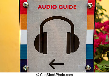 Close up audio guide sign
