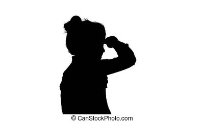 Silhouette Little girl looking away. - Close up. Back view. ...