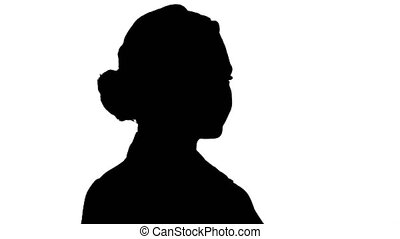 Silhouette Woman placing hands on her hips.
