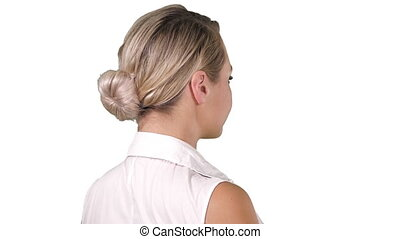 Woman placing hands on her hips on white background.