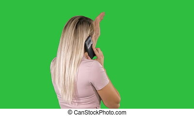 Woman talking on the phone on a Green Screen, Chroma Key.