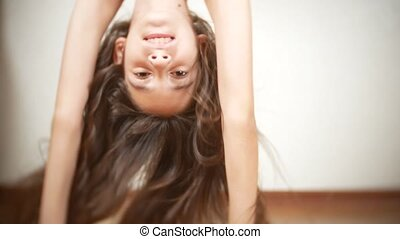 Close Up. bare feet of the young girl, dancing on the parquet floor in the hall.
