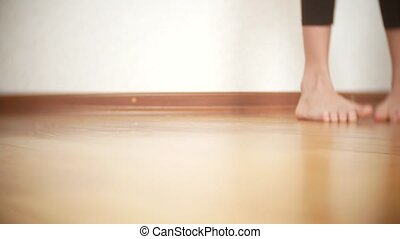 Close Up. bare feet of the young girl, dancing on the...