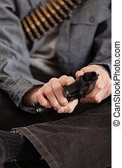 Close up Bare Hands of a Boy Cocking a Gun