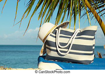 close up beach bag and hat