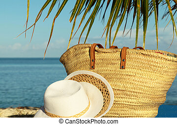 close up beach bag with sea view