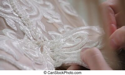 close-up beads and sequins, of needle and thread, embroider...