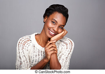 Close up beautiful african american woman smiling and leaning face on hand