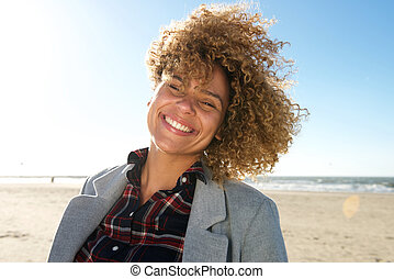 Close up beautiful african american woman smiling at the beach