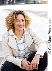 Close up beautiful african american woman smiling in city