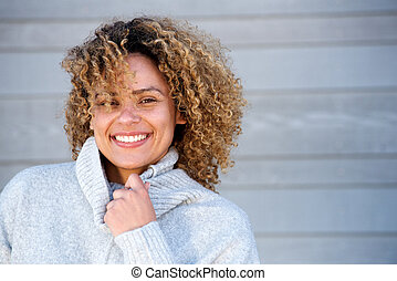 Close up beautiful african american woman smiling in warm sweater
