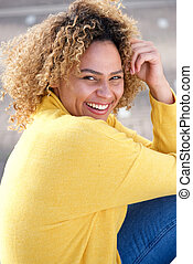 Close up beautiful african american woman smiling outdoors