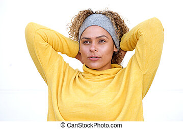 Close up beautiful african american woman staring with hands behind head against white background