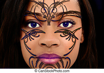 Close Up Beautiful Black Woman with Plastic Henna Art on Face