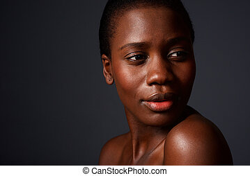 Close up beautiful face of a young african woman with clean skin