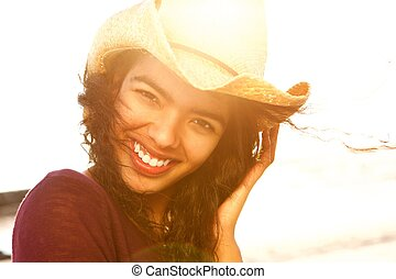 Close up beautiful fashion model smiling with hat