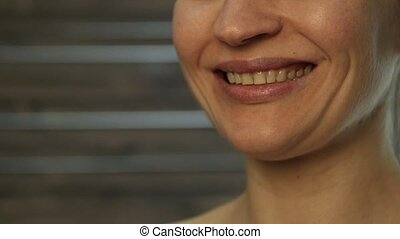 close up beautiful girl is smiling. slow motion
