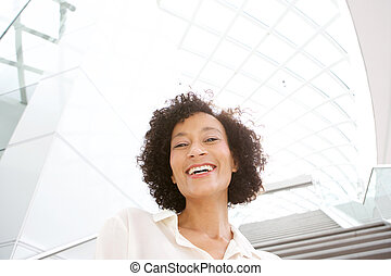 Close up beautiful middle age african american woman smiling
