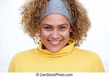 Close up beautiful smiling african american woman with curly hair against white background