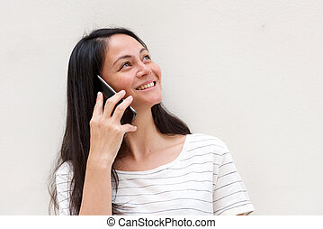 Close up beautiful smiling asian woman talking with cellphone