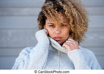 Close up beautiful young african american woman in warm sweater