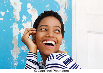 Close up beautiful young african american woman laughing