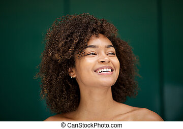 Close up beautiful young african american woman smiling and looking away