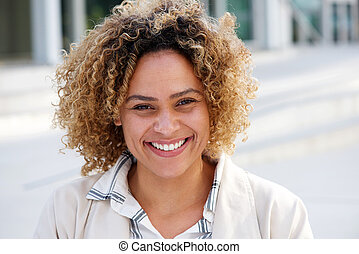 Close up beautiful young african american woman smiling outside