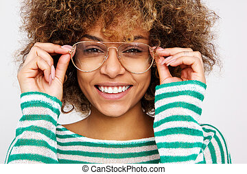 Close up beautiful young african american woman smiling with glasses