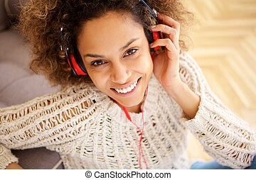 Close up beautiful young african american woman smiling with headphones