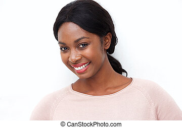 Close up beautiful young black woman smiling against isolated white background