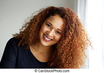 Close up beautiful young black woman with curly hair