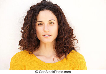 Close up beautiful young woman against white background