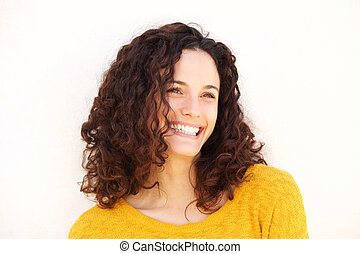 Close up beautiful young woman against white background smiling