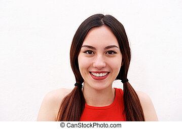 Close up beautiful young woman smiling on white background