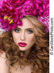 Close-up beauty portrait of young pretty girl with flower wreath