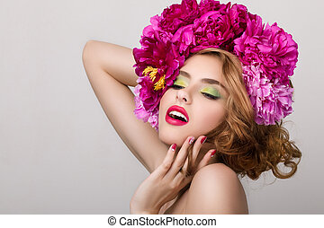 Close-up beauty portrait of young pretty girl with flowers...