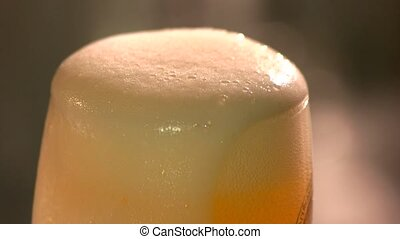 Close up beer froth motion.