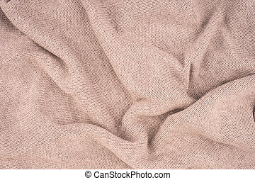 close up beige knitted pullover background.