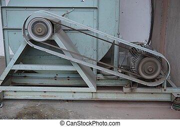 close up belt machine - close up old belt machine in factory
