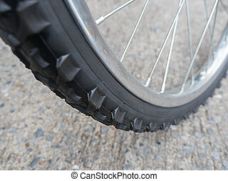 close-up bicycle wheel on road