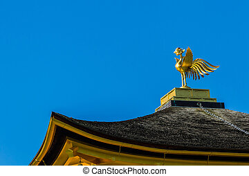 Bird sculpture on the top of the roof of Ginkaku-ji Temple in Ky