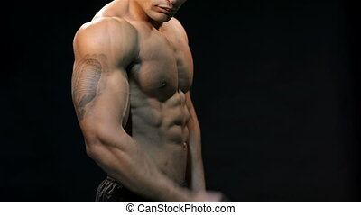 Close up black athletic man shows biceps