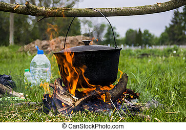cauldron on campfire