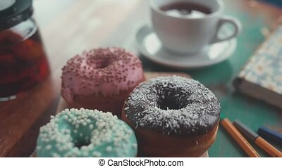 Close up: black tea and donuts. Morning composition on the table