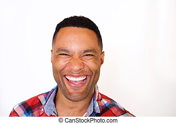 Close up black young man laughing against white background