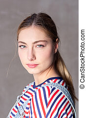 Close up blond girl with serious expression on face