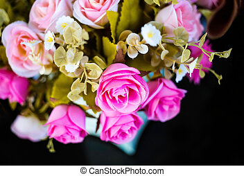 bouquet of pink roses on black background